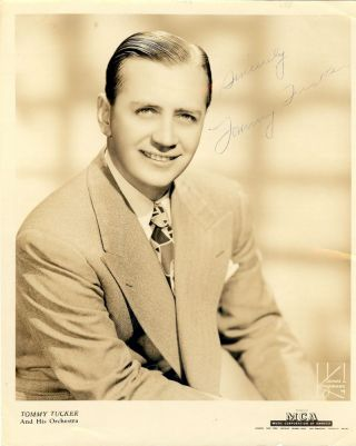SIGNED PHOTOGRAPH. Tommy TUCKER